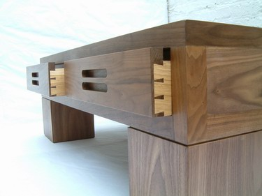 Walnut and oak coffee table showing hand-cut dovetails